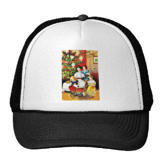 Navidad que saluda con la madre alrededor de su ch gorras de camionero