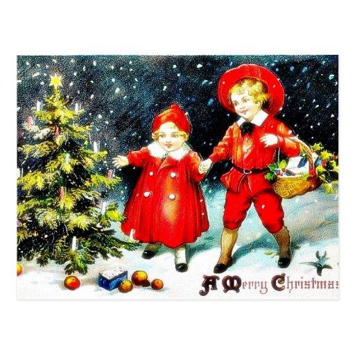 Navidad que saluda con la madre que cuida a su hij postal