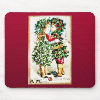 Navidad que saluda con licencia que lleva del much tapete de ratón