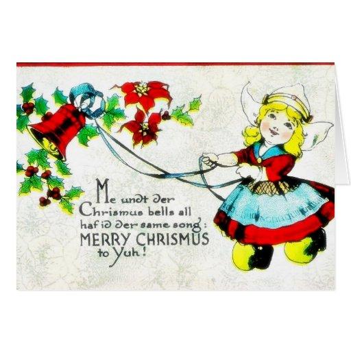 Navidad que saluda con los niños que juegan alrede tarjetas