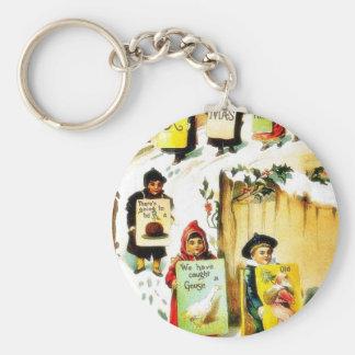 Navidad que saluda con los niños que llevan el jue llaveros