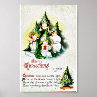Navidad que saluda con los niños que llevan el tre posters