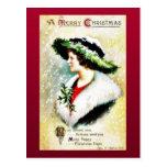 Navidad que saluda con los niños que llevan el tre tarjetas postales