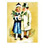 Navidad que saluda con los pares jovenes que camin postales