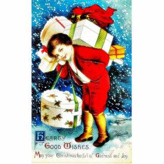 Navidad que saluda con los regalos que llevan de u escultura fotográfica