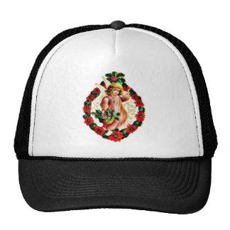 Navidad que saluda con un ángel sosteniendo la ce gorros