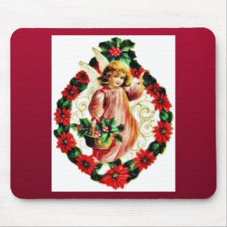 Navidad que saluda, con un ángel sosteniendo la ce alfombrillas de ratones