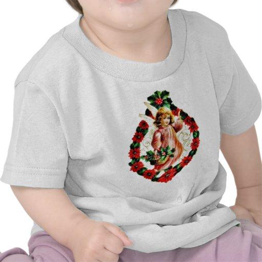 Navidad que saluda, con un ángel sosteniendo la camisetas