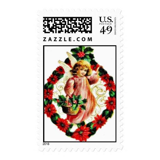 Navidad que saluda, con un ángel sosteniendo la sellos