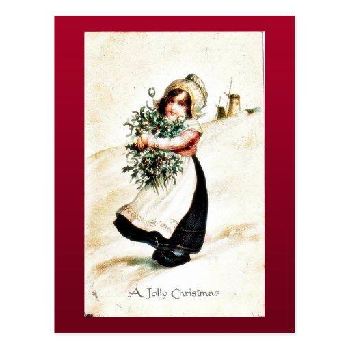 Navidad que saluda con un chica que lleva a cabo e postales