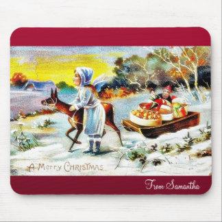 Navidad que saluda con una familia que se mueve co tapete de ratones