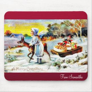 Navidad que saluda con una familia que se mueve co tapetes de ratones