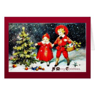 Navidad que saluda con una familia que se mueve co tarjeta de felicitación