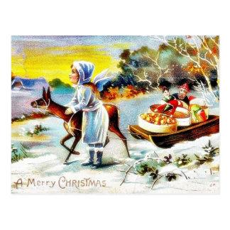 Navidad que saluda con una familia que se mueve co postal
