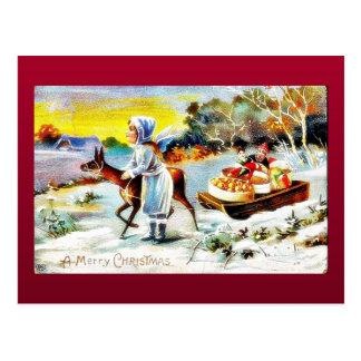 Navidad que saluda con una familia que se mueve co tarjetas postales