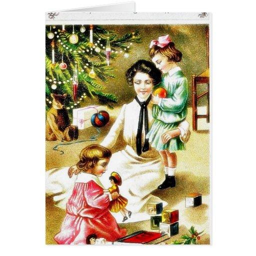 Navidad que saluda con una madre que juega con los tarjetas