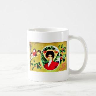 Navidad que saluda con una mujer y el sitt de dos  tazas