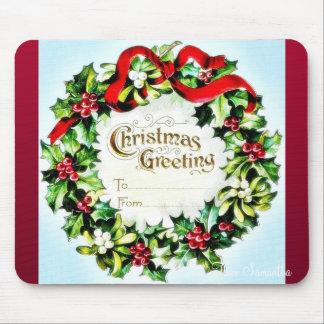 Navidad que saluda el sobre con la guirnalda alred tapete de ratón