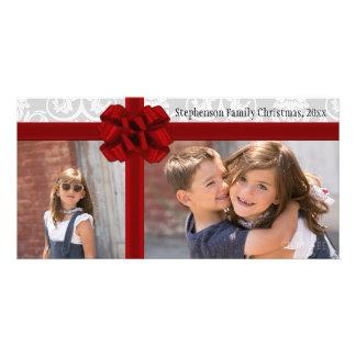 Navidad rojo del arco de la cinta que saluda plantilla para tarjeta de foto