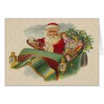 Navidad Santa del vintage en un coche antiguo clás Tarjetón