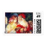 Navidad Santa del vintage y sellos del ángel
