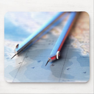 Navigation. Dividers sitting on a map. Mouse Pad