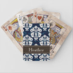"Navy Blue and Brown Damask Bicycle&#174; Playing Cards<br><div class=""desc"">This elegant navy blue and creamy white damask playing cards set can be personalized with your name on the dark brown PRINTED stitched ribbon look design. Accessorize your favorite gadget with a baroque meets French Country style case that looks sophisticated, luxurious and upscale. Designed by Chrissy H. Studios, LLC. All...</div>"