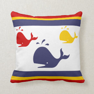 navy blue, yellow, and red whales on white throw pillow