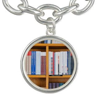 neatly set wooden  bookshelves charm bracelet
