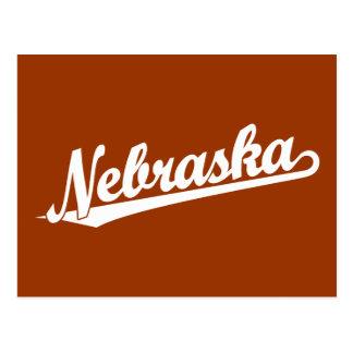 Nebraska script logo in white postcard