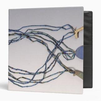 Necklace, found on a mummy vinyl binder