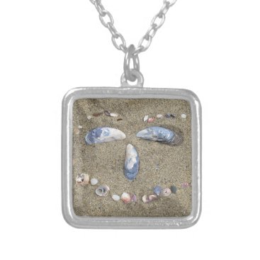 Beach Themed Necklace with face made in sand with sea shells
