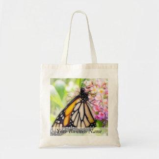 Néctar que sorbe de la mariposa de monarca bolsa lienzo