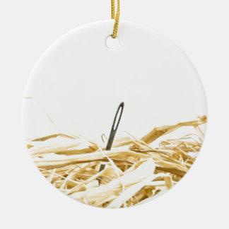 needle in a haystack ceramic ornament
