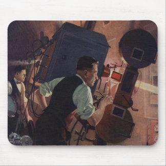 Negocio del vintage, operador de cámara en un cine alfombrillas de ratones