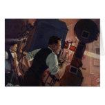 Negocio del vintage, operador de cámara en un cine tarjeta de felicitación