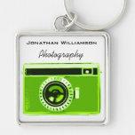 Negocio verde de la fotografía de la cámara llaveros personalizados