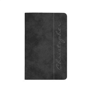 Negro abigarrado firma cuaderno grapado