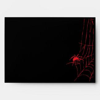 Negro con el Web de araña roja y el sobre de la ar