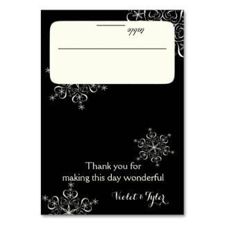 Negro de los copos de nieve y de la tarjeta blanca