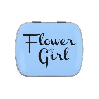 Negro del florista en azul frascos de caramelos