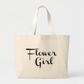 Negro del florista en blanco bolsas de mano
