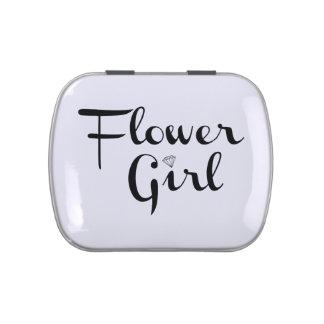 Negro del florista en blanco jarrones de caramelos