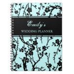 Negro del planificador del boda y cuaderno floral