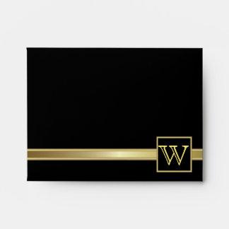 Negro ejecutivo con la placa del monograma del oro sobre