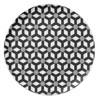 Negro en la placa tejada blanca del maleficio platos