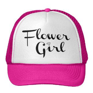 Negro retro de la escritura del florista en rosa gorro de camionero