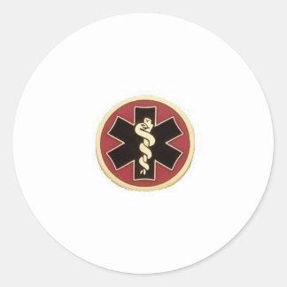 negro-rojo-oro pegatina redonda