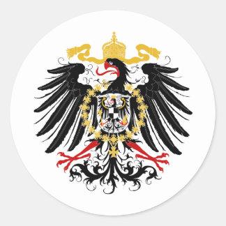Negro rojo prusiano y oro de Eagle Etiqueta Redonda