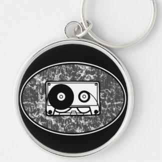 Negro y blanco de la cinta de casete llavero redondo plateado